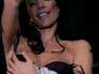 `Danielle Staub, formerly of `The Real Housewives of Fresh Jersey,` goes wild on a stripper pole at ScoresLive.com.`