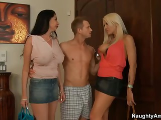 Two milfs. Michelle McLaren and Nadia Night. both with big milk cans and long legs meet Nadia's son's friend at home.  He is curious about sex with two busty moms. Slutty big boobed milfs strip. suck and get fucked!