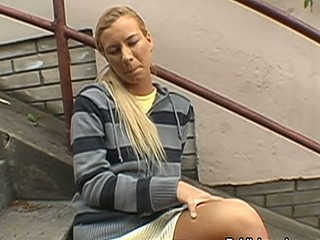 Blond in stripes enjoys being naughty in public