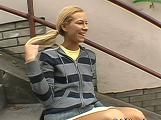 Blond in stripes enjoys being hideous in public