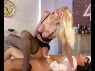 Breasty golden-haired European chick does the dirty deed with a nerd