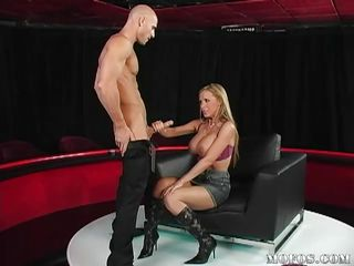 Watch this hawt blondy babe with huge melons as she gives this chap a quick blowjob and then she gets on top of him filling her constricted pussy with his big dick. She rides him like a pro and bounces her enourmous tits. It's a shame not to cum on  those huge melons and glamorous face, will he do that for her?