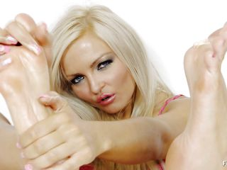 Nicky Angel is a hawt blonde babe with long legs that enjoys having fun with them. Watch her doing what that babe knows best with her gorgeous oiled feet. Do you think that that babe could use a real penis instead of a darksome dildo and maybe put it inside her tight juicy pussy and make it cum truly fast?