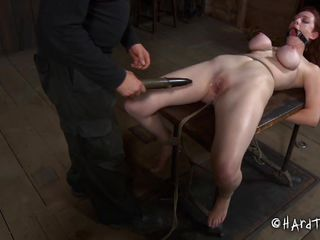 This a bdsm effectuated by a skilled executor. The guy did a great job when he tied Holly's big tits and squeezed them hard. Then he whips this whore and strapped on her head a simple device to keep her face hole opened. Holly received some lube on her face and pussy before deep face hole and vaginal fucking with a dildo