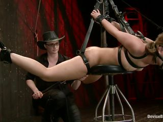bound with leather belts and hanged
