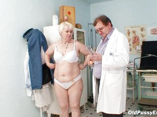 old battle-axe is being checked hard by her gynecologist.