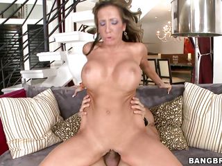 milf bouncing her melons while ridding a penis acquires filled