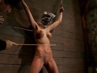 Watch this slut as she is tied on the wall and has a bag on her head. This babe is suffocating not fast and to increase the fun of being dominated they castigate her sexy body by thrashing her on the hips and belly with a stick. After thrashing she gets a vibrator on her cunt and moans with fun and pain. She's so sexy with these clamps on her hard nipples and, will they add greater amount weights?