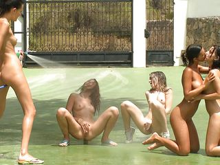 They are playing with a ball outside, these cuties are having a great outdoor fun and slowly get completely naked. All that playing made 'em hot and sweaty so why not cool down with some water and lesbo sex. One of 'em grabs a pantyhose and wets the others as they are staying with their legs spread and masturbate