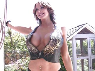 Brandy is posing in a sexy outfit and her big melons are peeping through it. There in that outdoor location, she takes of her tops and shows her mid blowing melons gifted by the nature. She is a Goddess with ideal body and big breasts. Her legs are pretty sexy too! She is amazing in showing her curves too!
