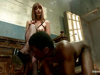 Alyssah Simone is a red head slut who wants to castigate this submissive black dudes for not following her orders. She puts a collar on his neck and swanks his ass. She makes him take off her heels and wants him to take up with the tongue her pink cunt so she can enjoy his humiliation.