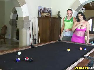 This hot brunette with big mangos is playing snooker with this punk. This guy gentle put his hand on her natural breasts, and begins squeezing them hard. That babe get's down on the couch, and these natural mangos are oiled up. In change for that, she takes his dick in her throat and softly gives a head. Will he cum on her?
