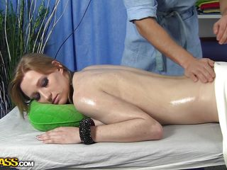 Lora has a beautiful fit body. She is relaxed as the masseur rubs her body and pours a lot of oil on it. Look at her sexy back, that perfect a-hole and how that guy slips his hand on her bald pussy. It will be a shame to let her go out of fucking her.