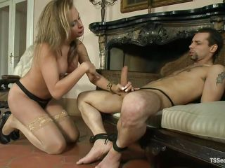 fashionable t-girl giving head to tied guy