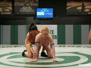 Adriana Luna and Darling are up for an ultimate lesbian wrestling showdown. although the brunette tries to dominate the match in the beginning as that babe tries to grab the blonde from behind but Adriana squeezes the boobs of Darling and takes over the rest of the match and wins it after which the brunette has to suck the strap on.