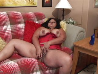 Melody is one of those bbw with a huge drive for sex. When that babe is home alone and doesn't have any cock available this naughty slut uses her favorite sex toy to do the job. Her big thighs are spread and that babe rubs and fingers the cunt between them showing us how horny that babe is. Wanna watch the rest of it?