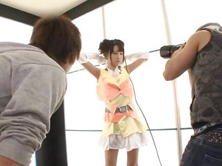 Sexy japanese wench with a mike in her hand is having a photoshoot in the studio. She slowly picks up her shirt and reveals her cute underwear and taut ass. The photographers start undress her to play with the bitch`s small tits and pink pussy. Uruha Mizuki likes it so much, she shows her wazoo for you!