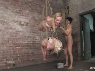 One brunette dominates and punishes 2 hot blondes. These 3 sluts are smoking hot but it's clear who's the boss her. The brunette got these babes all ties up and hanged them. Now she uses vibrators and electrodes to fun and torment them. How far is she going to go with the punishment?