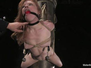 Sexy ginger Madison Young is fastened up to a pillar, hanging out face down. Clamped onto her nipples are weights. She's acquires sprayed but he wishes a jet that will move the weights. He acquires a more strong sprayer going and aims it at her pussy, then wedges a vibrator betwixt her snatch and the pillar.