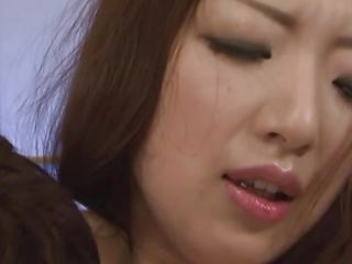 oriental milf bends over with pleasure