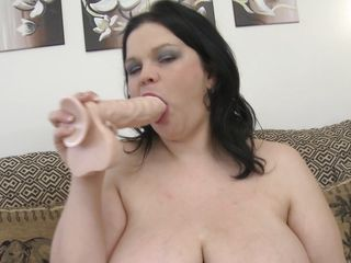 chubby brunette mature plays with her huge bazookas and shaved cunt
