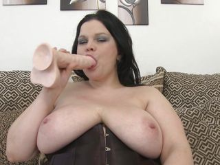 chubby brunette mature plays with her biggest boobs and shaved cunt