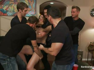 Five horny men want to play with their slutty girlfriend Sarah. They put her on a table, after ripping her whore garments off. They begin to spank the bitch, her small wobblers and wet cunt of hers. The slut can't live without being fucked hard in her pussy and also to suck their big hard cocks. She`ll be filled with cum!