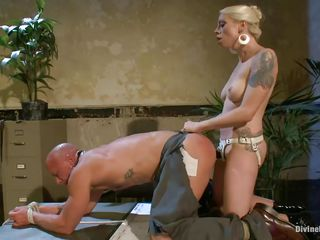 Chad Rock thinks he'll impress mistress Lorelei Lee with his business suit. She's unimpressed. This babe copulates him from behind on the desk with her black strap-on then flips him over on his back and pounds his ass harder. This babe strokes the bitch boy's dong and allows him to squirt his spunk all over himself.