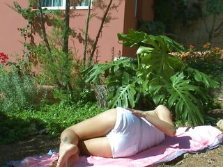 hot ass wench masturbating while sunbathing