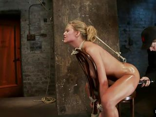 golden-haired gives head while having a metal hook in her ass