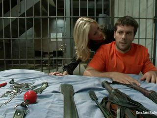 Looks like this playgirl blonde milf, Simone Sonay is some kind of in-charge in a prison facility. Now here she is horny and crazy, submitting herself to a random prisoner named Ramon Nomar. He's playing with her with the toys she brought and in no time this guy starts fucking her like a bitch from behind!