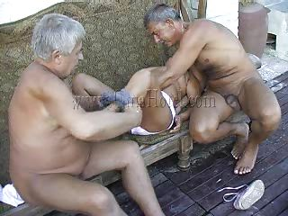 These 2 old farts where looking in a porn magazine when granny Heidrun caught them. As lengthy they were all there they've began fucking and formed a threesome. The granny was naked by the old dudes and they've started to grope her boobs and massage her saggy cunt. Will they fill her with semen?