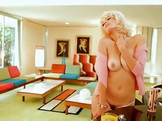 This lovely blond Playmate is showing off her marvelous body during photo shoots. Different locations and different poses, she does well for them all. Throughout the segment she talks of her life and family, interests and what she thinks of being a Playboy Playmate and what it does for women.