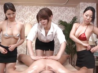 These three beautiful asian milfs undressed in front of me and gave me a sensual oily massage. Whilst I was busy groping the boobs of 2 of them the third one took care of my pecker and frankly it felt heavenly. Now my nipples are getting sucked and maybe my hairy pecker will get the same thing too.