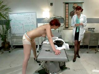 This is the kind of doc that you will barely wait to see. She's a devilish redhead with a passion to dominated, especially other sluts! Her patient came for a routine check and found herself undressed and a-hole slapped until that sexy a-hole turned red. Now that the doc slapped her she licks her booty with passion.