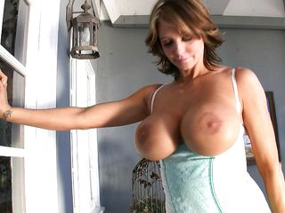 horny milf putting lotion on her melons
