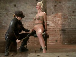 Hot babe Tara is being punished by this skilled mistress. She will have the sex experience of her life so this will be pleasure to watch! After the female-dominant bound her on that wooden beam that babe how laid her on her back and inserted a booty plug in her anus. Tara stays there with her hips widen and awaits some more!