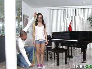 Piano lesson can be hard work for such a tiny Hispanic chick. That babe could more good use some blowjob lessons instead! This is where this large guy gets in the picture. He is a lot taller then she is and has a large penis for her pretty mouth. The dorky hottie kneels with obedience and gives him a suck and then her sexy ass