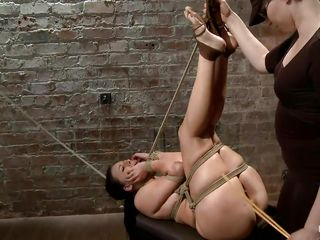 tied brunette hair gets a torment that makes her ass red