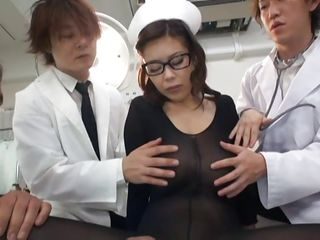 She is in the midst of attention and loves it. All these doctors are inspecting her and cut a hole between her hot thighs to have access to her cunt. They grope her boobs and finger her pussy from behind as that babe gives head to one of the doc's. Want to see what kind of experiments they will do on her?