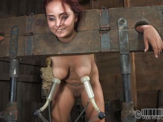 Ashley Graham is bound up in shackles with a milking machine attached to her giant breasts. She a dirty doxy and these studs punish her with humiliating tasks. She's bound to her chair so you can acquire a better look at her massive melons.