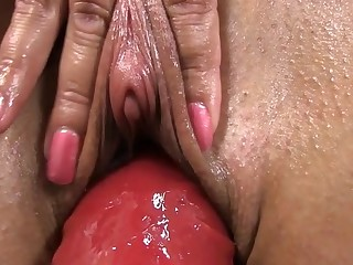 Appealing darling triggering the brush lusty twat with wild marital-device play