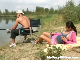 A dude is out fishing at the river when his girlfriend approaches. She is not very interested in what this chab is ding so this babe lays down and shows him a vibrator. Then this chab comes up to her in order to lick her pussy, pushing two fingers inside