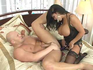Dark haired bitch with a strap-on fucks her freaky comrade-in-arms so hard