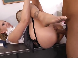 Huge dicked black teacher Ethan Hunt is naughtily fucking his workmate blonde teacher babe Julia Ann on his desk.
