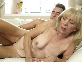 Blonde mature woman asks youngster boy to make her happy