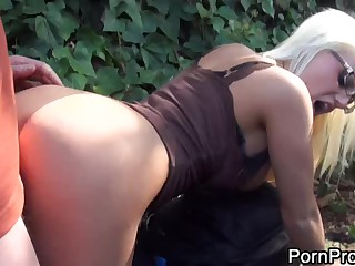Glassed golden-haired with round ass Jacky Joy takes dick doggy style
