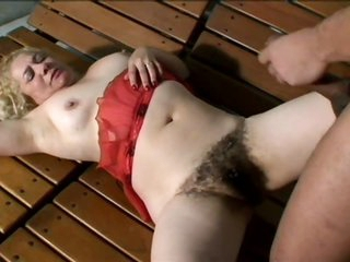 Breasty Blonde Mature With a Thick Bush Sucks Cock and Then Gets Banged