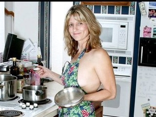 Nice-looking housewife widens her fur flan with a blundering spoon
