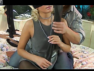 Blindfolded suitor in darkling pantyhose uses nylon encasements couple on touching a baffle